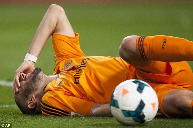 Return: Madrid striker Karim Benzema is set to to return after injuring himself against Malaga last week