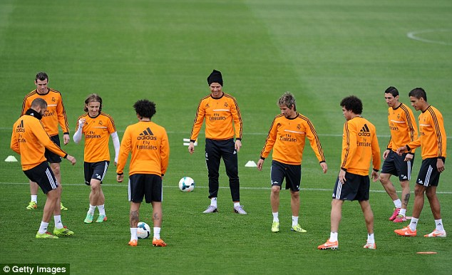Practice makes perfect: League leaders Real Madrid pass the ball around during Saturday's training session