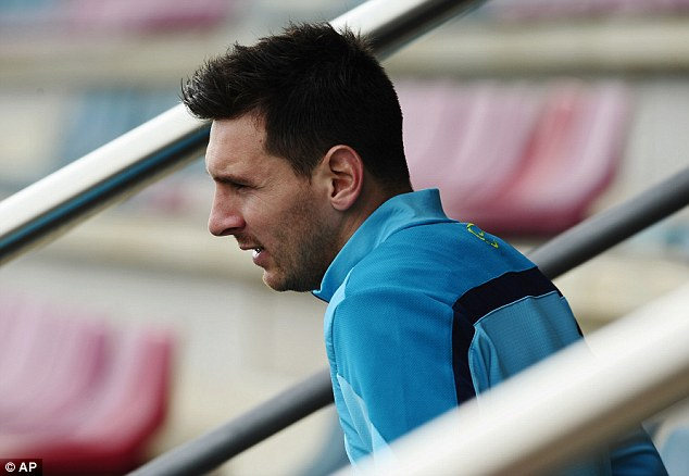 Star man: Lionel Messi climbs the steps at Barcelona's Sports Centre on Saturday