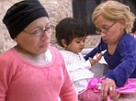 Playing doctor: Jen Arnold played doctor with adopted daughter Zoey on Tuesday's episode of The Little Couple to help the girl prepare for her first checkup