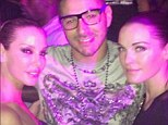 All smiles: Real Madrid striker Karim Benzema posted a photo of himself posing with two females to Instagram