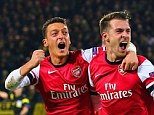 Recovery: Aaron Ramsey and Mesut Ozil are both set to be back for Arsenal in the coming month