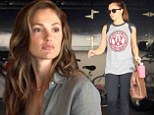 Minka Kelly treats herself to a bouquet of flowers and a healthy green tea before sweating it out at the gym