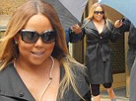 In addition to the layers of makeup, Mariah also wore a pair of three-quarter leggings with a plunging neckline top under a long trench.