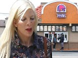 Painfully thin Tori Spelling treats children to  takeout from fast food chain Taco Bell amid reports of money woes