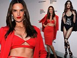 Bra-vo! Lady in red Alessandra Ambrosio flashes her cleavage at clothing collection launch in New York
