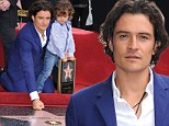 Newly single Orlando Bloom and son Flynn unveil his star on the Hollywood Walk of Fame