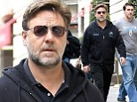 Gladiator no more! Russell Crowe looks plump in Paris as he promotes Noah