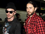 Not too posh for public transport! Oscar-winner Jared Leto rides the train in Tokyo with brother Shannon ahead of 30 Seconds To Mars gig