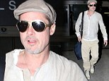 Brad Pitt is on a flying winner's streak in beige as he lands at LAX after taking on yet another project