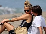 Love was in the air for Kate Hudson and boyfriend Matt Bellamy as they enjoyed some family fun on the beach with her son Ryder Robinson in Malibu, California