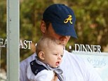 Morning workout: Josh Duhamel put his big biceps to use holding sailor-clad baby boy Axl with one arm while exiting a Brentwood cafe Wednesday