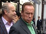Who's laughing now? Arnold Schwarzenegger pulled funny faces at Kelsey Grammer's daughter Faith as the pair ran into each other while out in London on Wednesday