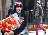 Well it is laundry day! Sarah Silverman steps out in pyjama bottoms after dropping a huge bag of clothes at cleaners
