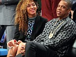 Beyoncé indulges in a large glass of wine courtside as she watches basketball game with husband Jay Z