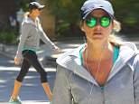 Pregnant Stacy Keibler covers her bump with a loose jacket as she maintains her exercise regime on a gentle hike
