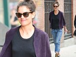 Back to work! Katie Holmes flashes a rare smile as she dons casual clothes on the set of Dangerous Liaisons