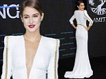 Brunette beauty: Shailene Woodley wowed in a plunging white gown at the German premiere of Divergent on Tuesday evening