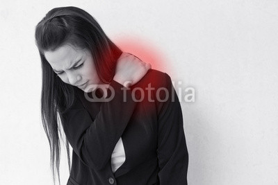 heavy shoulder pain or stiffness of business woman