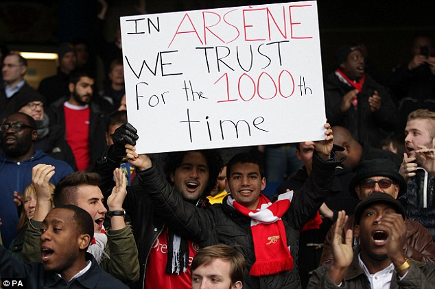 in Arsene we trust: Gunners fans were decidedly more upbeat before the game at Stamford Bridge