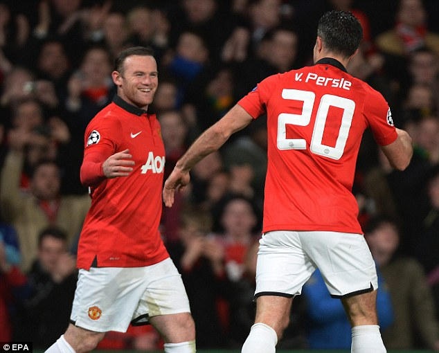 Wishful thinking: Rooney (left) said United could win the Champions League after they beat Olympiacos