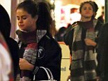 Fun-loving: Selena Gomez and friends are seen leaving Disneyland at midnight