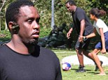 Huffing and 'puffing'? Sean 'Puff Daddy' Combs looked a bit out of shape - showing some belly under a black T-shirt as he kicked around a soccer ball with four kids in Los Angeles on Saturday
