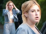 Late night? A woozy Scout Willis shows off her stomach in tiny crop top and comfy pantsuit after a night out with her sisters