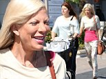 The stress is really starting to show: Mother-of-four Tori Spelling looks worryingly thin as she leaves craft store