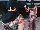 Now THAT'S a sneak peek! Lady Gaga shrouds her head in scarf and veil as she steps out in see-through flowered dress