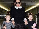 Memphis memories: Lisa Marie Presley holds her twin daughters' hands as they walk in cowboy boots through Narita International Airport