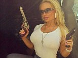"""Gunslinger: On Saturday, Coco Austin Instagrammed an image of herself wielding a couple guns while on set, with the caption, 'Just call me """"Action Jackson"""" today!! LOL Behind the scenes of Body Count Music Video'"""