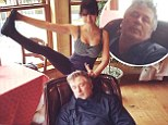 'He's trying to steal my thunder!' Hilaria Baldwin shows off her yoga move while Alec takes a snooze in funny photobomb