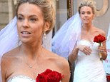 Here comes the bride! Kate Gosselin sports a feathery white wedding dress and band while on the streets of New York for Celebrity Apprentice