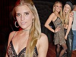 Shouldn't you be wearing stripes? Tigerlily Taylor wears leopard print and lace slip to nightclub opening