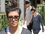 The look of love! Kourtney Kardashian and Scott Disick enjoy hand-in-hand stroll after 'scouting wedding venues' together