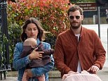 Jamie Dornan hides his tired eyes behind sunglasses as he steps out with wife and baby daughter the morning after double award success