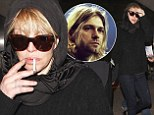 Memoria: Sombre Courtney Love wears black headscarf as she jets into LAX before 20th anniversary of Kurt Cobain's death