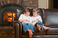 Children Reading by the Fireside