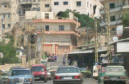 The entrance to Syria Street from behind the Bab Al Tabbaneh market. The apartment buildings on the hill serve as sniper spots for gunfire into Jebel Mohsen. // Source: Nicholas A. Heras