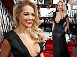 Rita Ora wows in plunging black gown