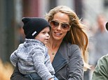 Elizabeth Berkley looked every inch the doting mother as she enjoyed an outing in New York with her husband and baby son