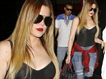 Khloe Kardashian shows off her trimmer form in plunging bodytop and knee length boots as she dines with French Montana