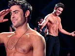 Pale faced cheek! Heartthrob Zac Efron shows off 'painted on abs' as he suffers tanning disaster at MTV Movie Awards