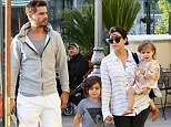 Back on parenting duty: Kourtney Kardashian and Scott Disick treated children Mason and Penelope to ice-cream during an outing near their home in Calabasas, California on Sunday following a whirlwind trip to Las Vegas the previous day