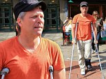 That looks painful! Jon Bon Jovi plasters on a smile as he hobbles along on crutches to have lunch with wife Dorothea