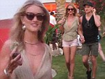 Rosie Huntington-Whiteley is all legs wearing shorts along with a low cut top at Day 2 of Coachella Music Festival