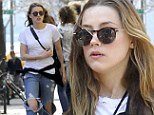 Grungy: With her fiancé thousands of miles away, Amber Heard perhaps felt no need to impress, as she stepped out in Manhattan in tattered cuffed blue jeans with her knees exposed through enormous holes
