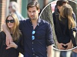 Reunited and it feels SO good! Johannes Huebl gives fiancée Olivia Palermo a cheeky squeeze on the bottom as they get amorous during New York stroll