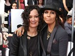 Newlyweds Sara Gilbert and Linda Perry display similar styles during first public appearance since tying the knot a fortnight ago at MTV Movie Awards